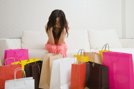 Worried woman and shopping bags